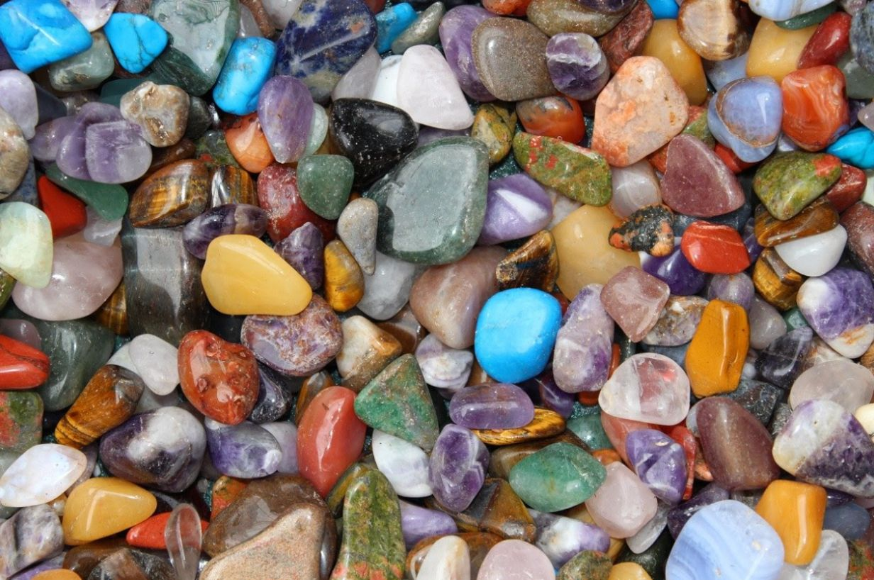a bunch of colorful gemstones