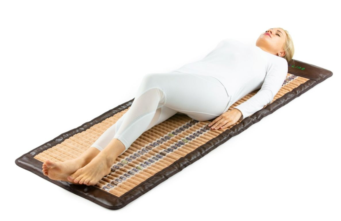 Woman laying on a HealthyLine far infrared mat
