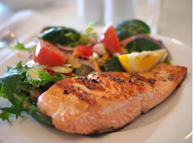cooked salmon with lettuce and vegetables