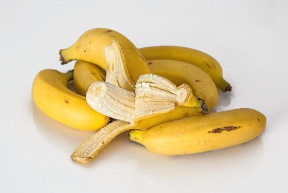 A bushel of bananas with one open