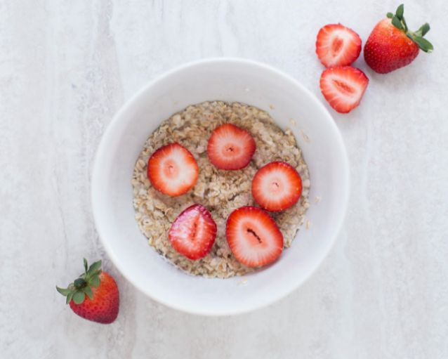 Oatmeal in a bowl with strawberries
