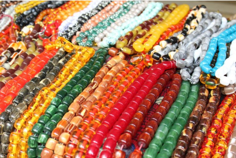 Bright beads and gemstone jewelry in market